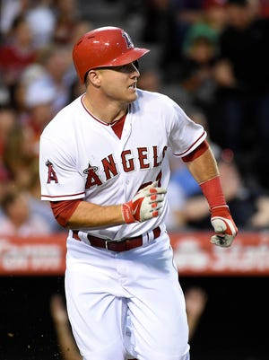 Angels center fielder Mike Trout watches his home run during the third inning against the Yankees at Angel Stadium of Anaheim.