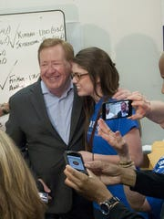 Carmel mayor Jim Brainard and his daughter Marie celebrate