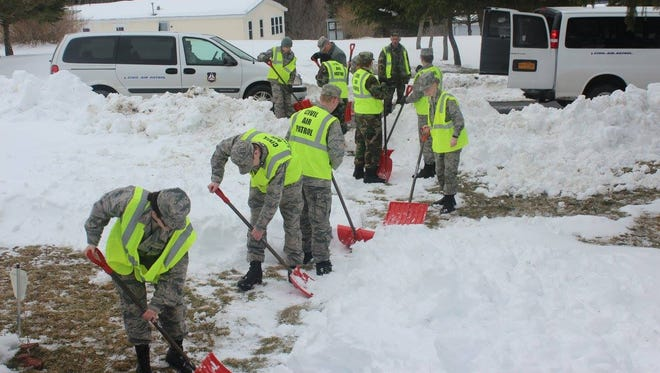 Members of the South Central Group, New York Wing, Civil Air Patrol, help dig out of the storm at March 19.