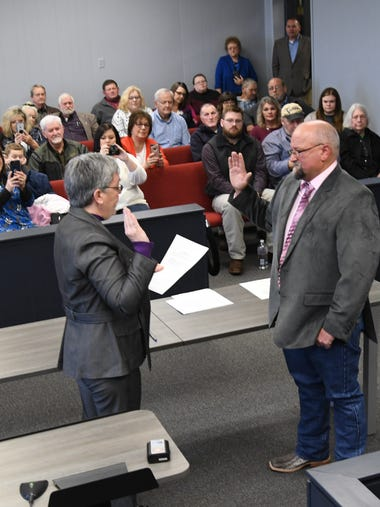 County Judge John Massey is sworn in Tuesday by Circuit