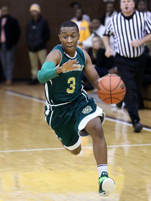 Crispus Attucks' Isaiah Waire moves the ball up the court  during a scrimmage against Howe Friday November 21, 2014.
