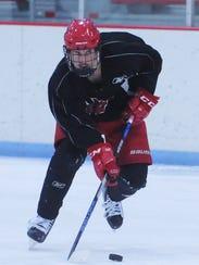 Arrowhead's Ben Beversdorf brings the puck up ice during
