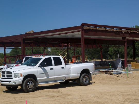 Construction work on Monday at the future site of O'Reilly's Auto Parts located on W. Aztec Boulevard in Aztec.