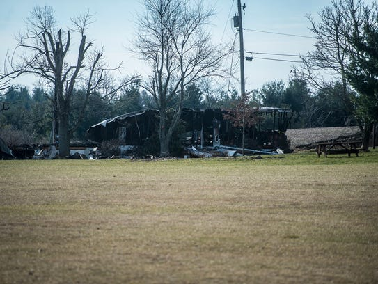 The mobile home damaged in the early morning fire on