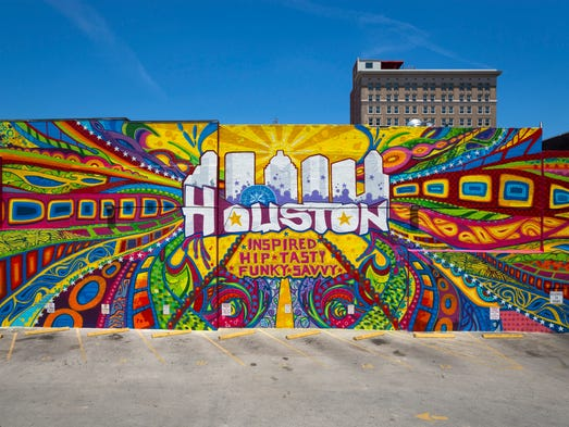 Graffiti artist GONZO247 created a large mural in downtown
