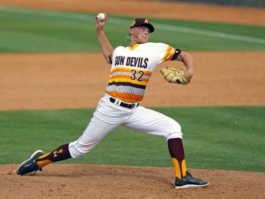Arizona State pitcher Ryan Burr (32) throws in the