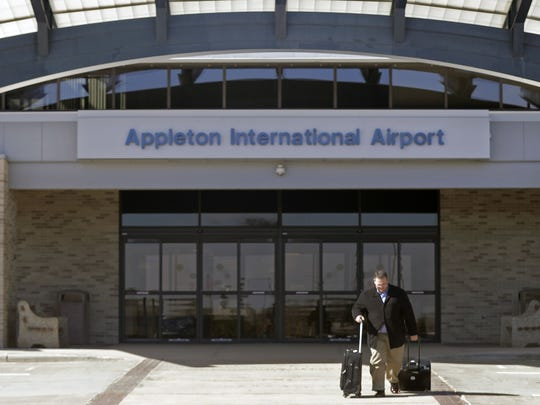 A traveler leaves the Appleton International Airport in Greenville on Friday.