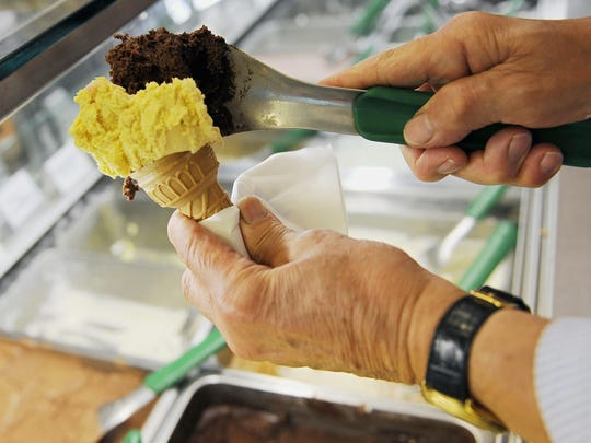 Italian ice cream called gelato being scooped in Rome,