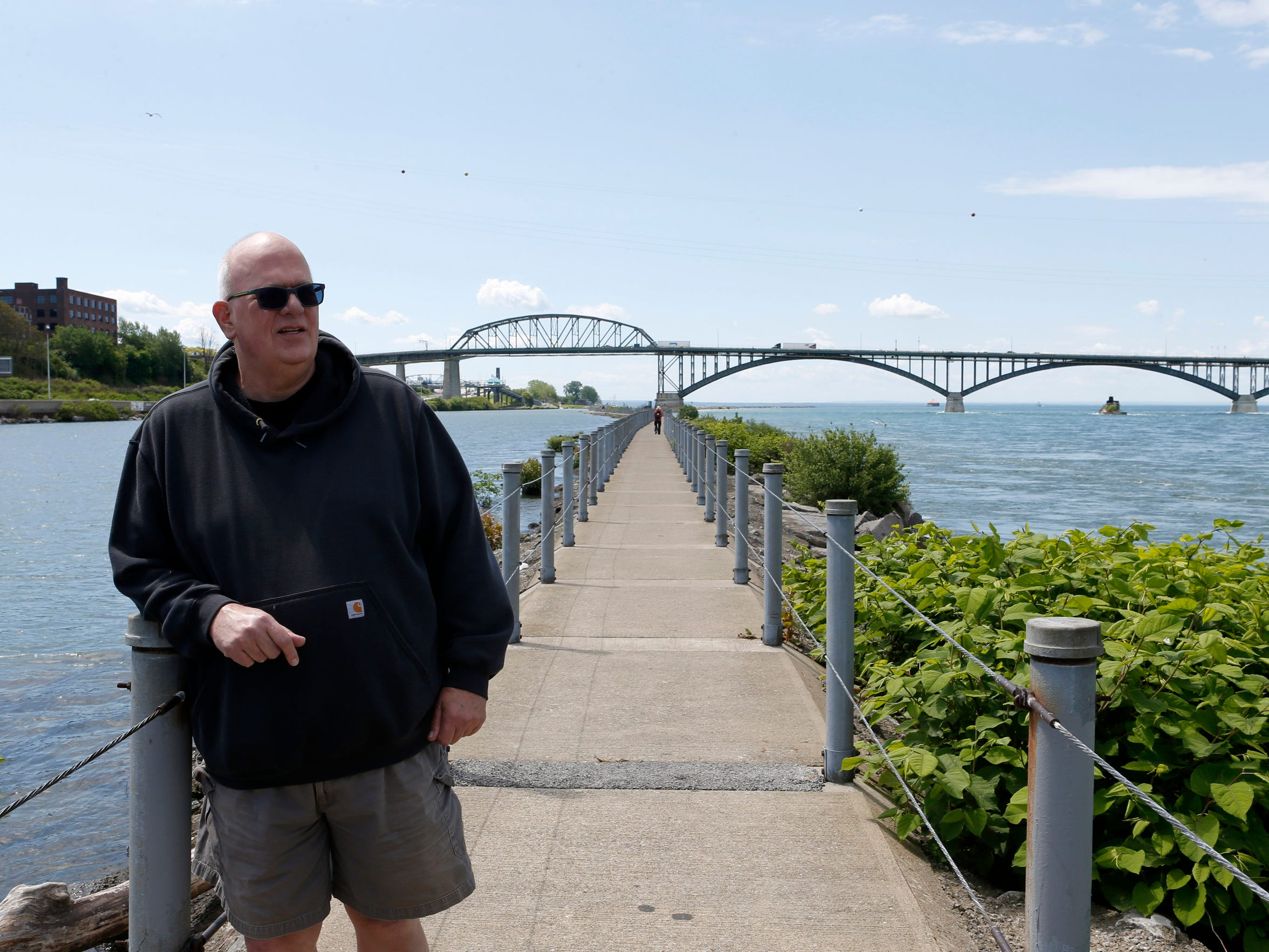 Bruce Beyer stands near the Peace Bridge 40 years after