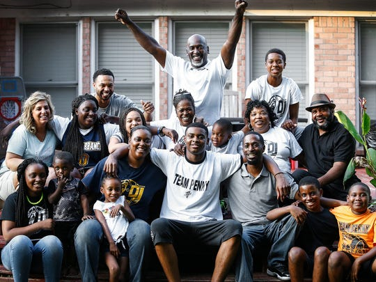 Team Penny forward D.J. Jeffries (middle) poses with extended family members at his home in Olive Branch, Miss. Jeffries, a five-star recruit, is ranked as one of the best players in the Class of 2019.