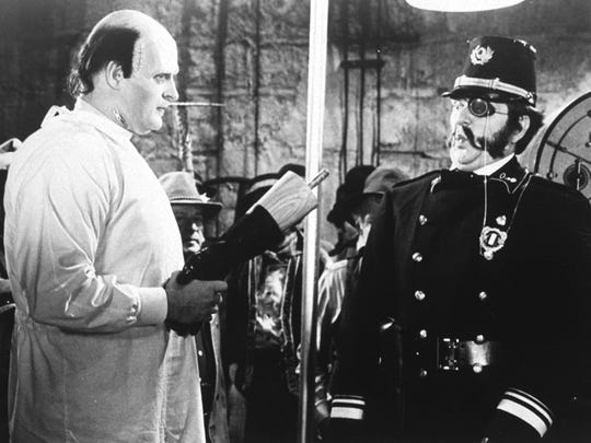 """Peter Boyle, as the monster, hands Kenneth Mar, the police chief, a shock in a scene from Mel Brook's 1974 film """"Young Frankenstein.""""   The film is showing at 7 p.m. Oct. 4 at the Historic Elsinore Theater. $6."""