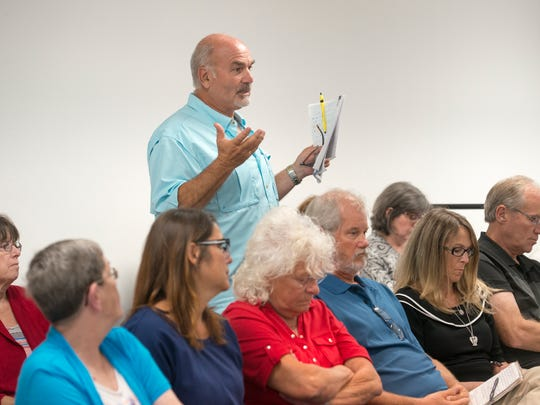 Monterey Shores resident Gary Barto speaks during a public meeting on Tuesday, October 17, 2017 to discuss controlling red-clay sediment run-off into Indian Bayou in Santa Rosa County.