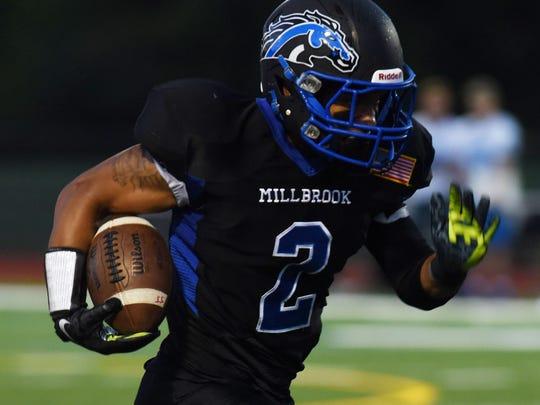 Millbrook running back Delvin Wood breaks a run against Sullivan West on Sept. 11, 2015.