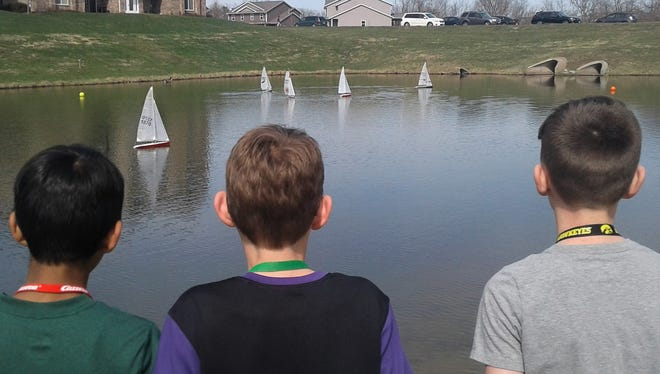 The small pond at Creekside Commons Park in North Liberty was filled with radio-controlled sailboats and young would-be sailors during the TAKO event here on April 20.