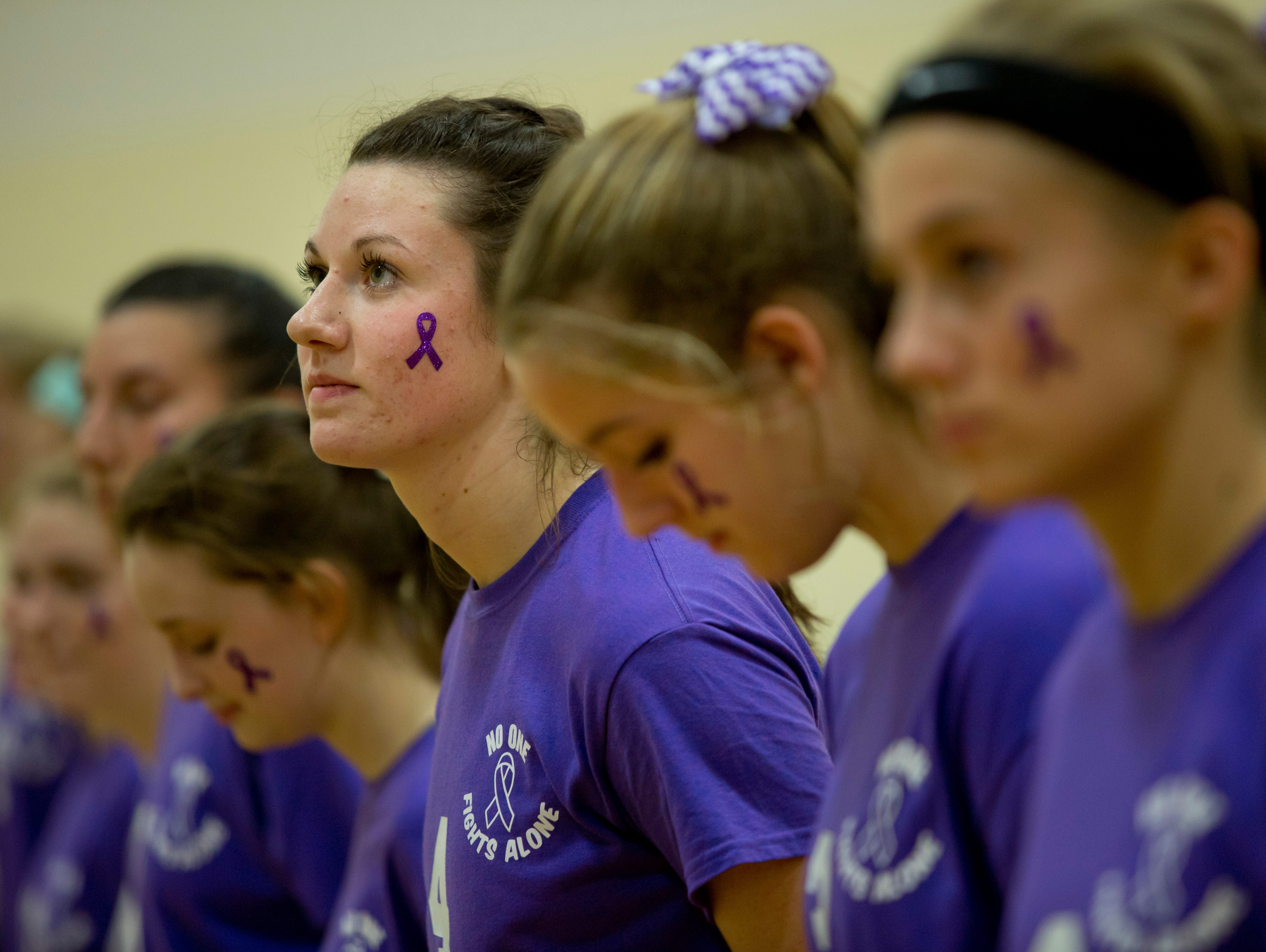 Cardinal Mooney senior Calista Chaltron looks up during the National Anthem during a volleyball game Wednesday, October 28, 2015 at Cardinal Mooney High School.