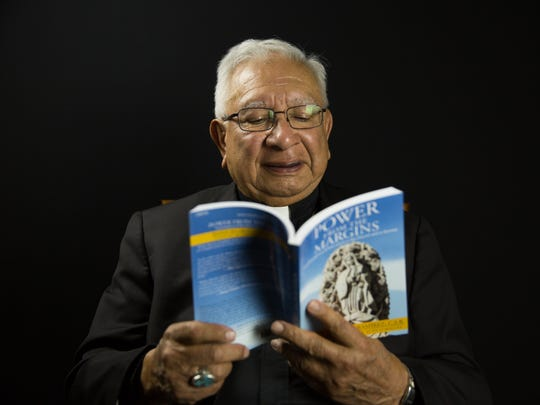 "Bishop Emeritus Ricardo Ramírez reads from his new book ""Power From The Margins."" The Catholic Diocese will be holding celebrations Sept. 8 and 11 to mark a number of milestones for Ramírez, including his 80th birthday and the publication of his first book."