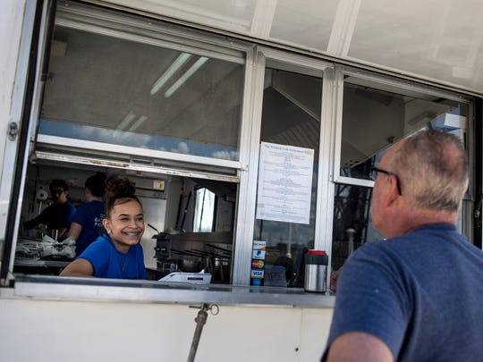 Joe Ziegler, of St. Clair, orders from Sophie Jackson, 18, of Port Huron, Monday, June 19, 2017 at The Wicked Fish at Vantage Point in Port Huron.
