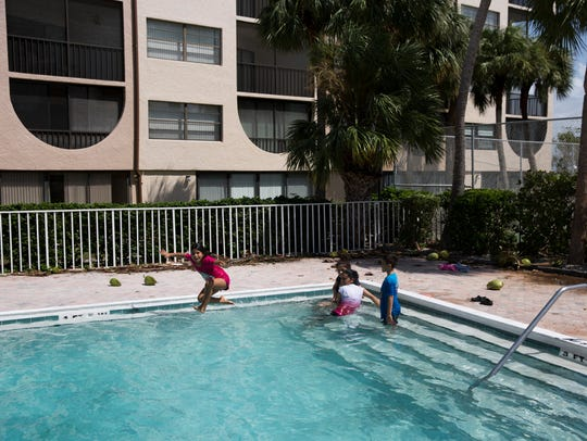 Astrid Santos, 9, jumps into the pool at Angler's Cover