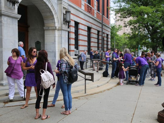 Supporters of Nicole Addimando stand outside of Dutchess County Court on June 5, 2018. Addimando was charged with the murder of her live-in boyfriend, Christopher Grover, in September 2017. Addimando's loved ones and attorney say she was a victim of domestic violence.