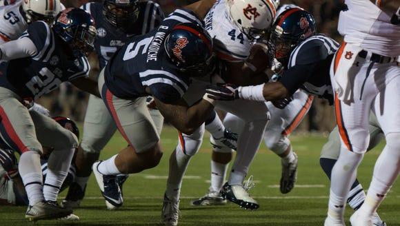 Auburn running back Cameron Artis-Payne (44) scores