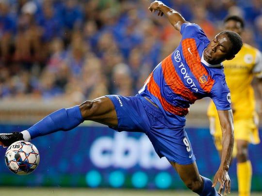 FC Cincinnati forward Fanendo Adi (9) stretches for