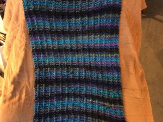 My one-row scarf pattern self-striping prayer shawl is only 3 feet long, but it seems longer than that.