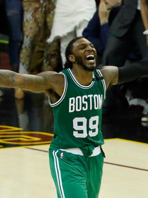 Boston Celtics forward Jae Crowder (99) celebrates a three point basket by guard Avery Bradley (not pictured) in the fourth quarter against Cleveland Cavaliers in Game 3 of the Eastern Conference finals.