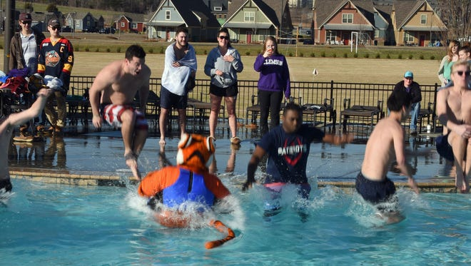 A handful of Clemson students joined the Tiger mascot Sunday for the inaugural Tiger  Paw Polar Plunge.