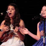 """Kylie McGuffey and Caroline Siegrist sang a duet of """"And the Birds Sing"""" by Tyrone Wells in Louisville's Got Talent 2014. The pair were first place winners."""