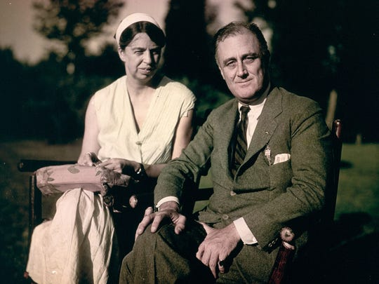 Eleanor and Franklin Roosevelt sit on the lawn at Springwood shortly after FDR received the Democratic Party's presidential nomination, in August 1932.