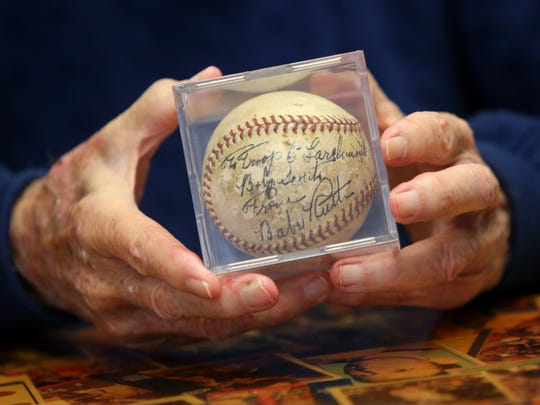 Jack Coughlin, 93, holds the Babe Ruth-autographed