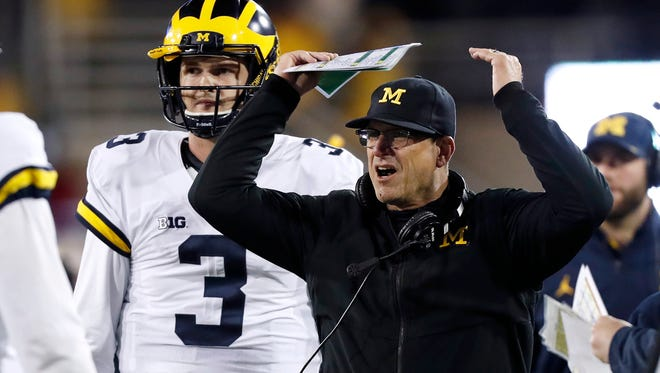 Michigan Wolverines coach Jim Harbaugh reacts to a call in front of quarterback Wilton Speight during the second half against Iowa, Saturday, Nov. 12, 2016 in Iowa City. Iowa won 14-13.