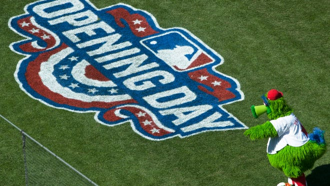 The Phillie Phanatic takes to the field during the pregame ceremony of the home opener at Citizens Bank Park in Philadelphia on Monday afternoon.