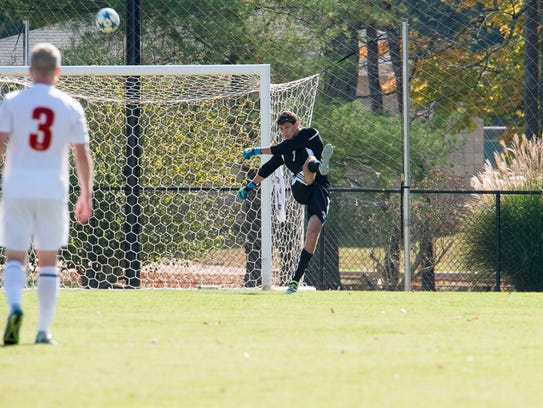 USI goalkeeper Adam Zehme clears a ball during a GLVC