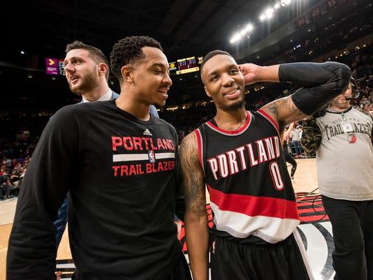 Portland Trail Blazers guard Damian Lillard (0) celebrates