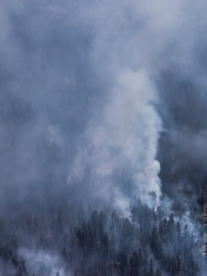 A wildfire is seen from a Canadian Forces Chinook helicopter near Williams Lake, British Columbia, on July 31, 2017.