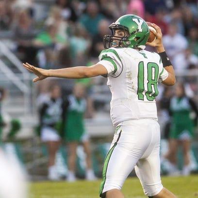Yorktown's quarterback Brogan Miller looks for an opening