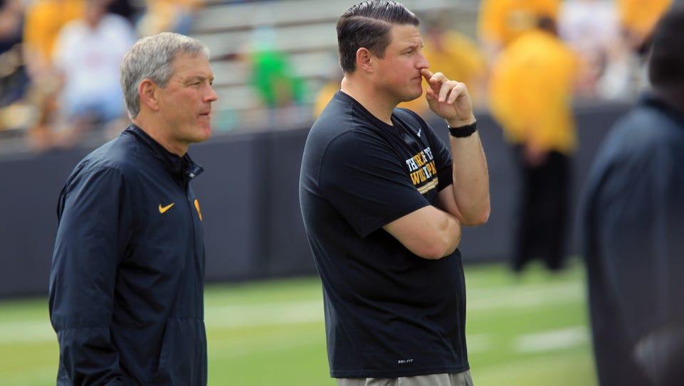 Iowa football coach Kirk Ferentz, left, and his son,