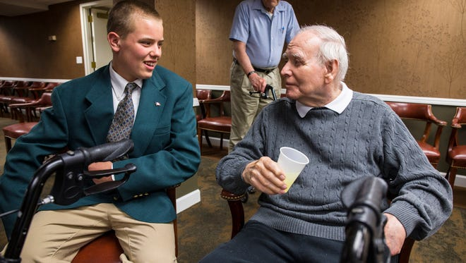Eighth-grader Andy Murphy, who played Gov. Ray in their production, talks with Gov. Robert Ray after four students from St. Benedict School in Decorah presented their National History Day project.