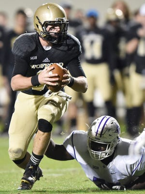 Wofford's Evan Jacks (3) breaks away from a Furman tackler during the 2015 season.