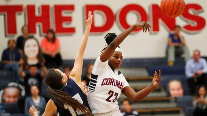 Coronado's Zhiri Cephes wins the opening tip from Higley's Bianca Rodriguez during a game in Scottsdale, Ariz., on Jan. 29, 2018.