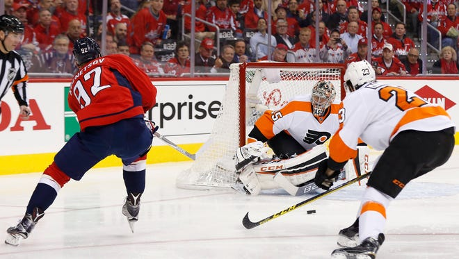 With Flyers defenseman Brandon Manning, right, in pursuit, goalie Steve Mason makes a save on Capitals center Evgeny Kuznetsov (92) in the first period of Game 1 of the Eastern Conference's first-round matchup on Thursday, a 2-0 win for Washington.