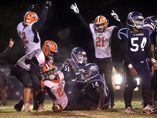 South Gibson's Dre McAllister shows referees the ball's position after scoring a touchdown Friday, Oct. 27, 2017, during South Gibson's 27-14 victory over Milan at Johnnie Hall Stadium in Milan.