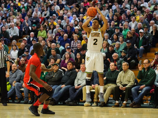 Vermont's Trae Bell-Haynes (2) shoots 3-pointer during the men's basketball game earlier this season.
