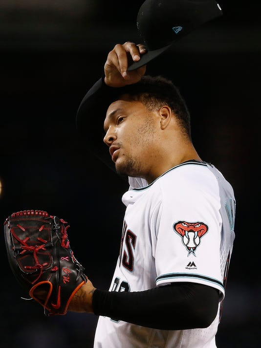 Arizona Diamondbacks' Taijuan Walker pauses on the mound after giving up a run to the St. Louis Cardinals during the first inning of a baseball game, Tuesday, June 27, 2017, in Phoenix. (AP Photo/Ross D. Franklin)