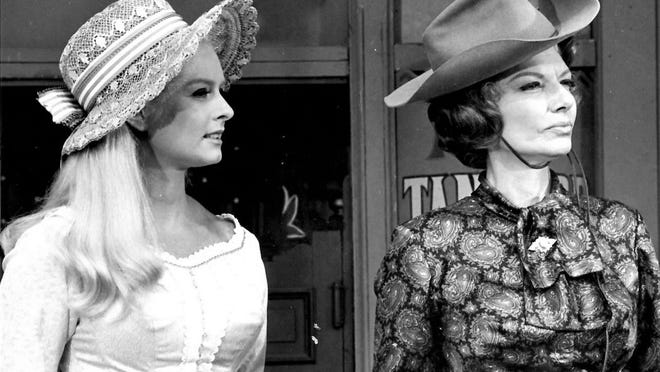"Carole Wells (left) and Ann Sheridan in ""Pistols 'n' Petticoats."""