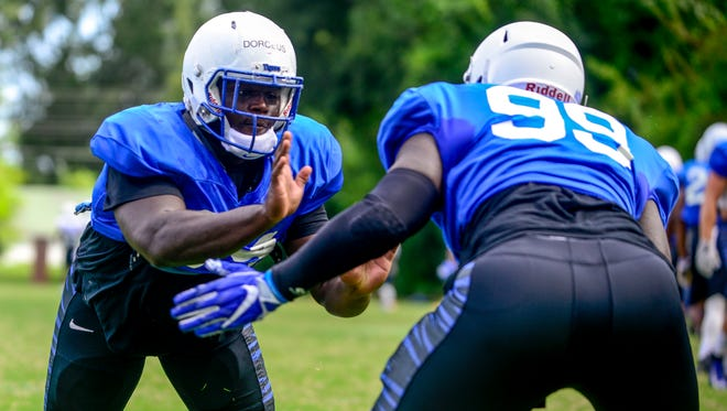 Memphis' Joseph Dorceus (94) runs drills with Memphis' Braylon Brown (99) during a practice and scrimmage for the University of Memphis football team at Universty of Memphis Lambuth in Jackson, Tenn., on Saturday, Aug. 18, 2018.