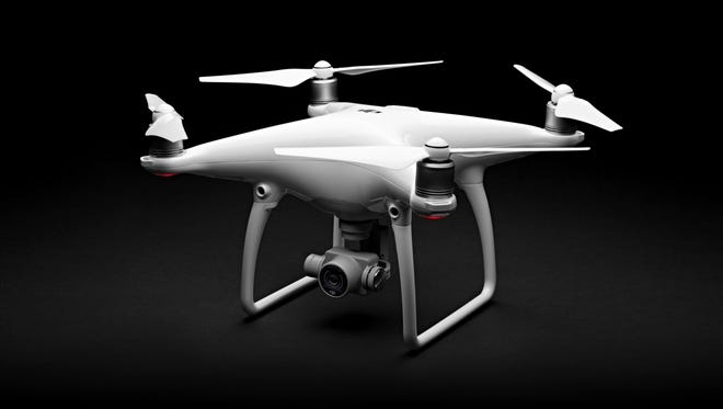 A Phantom 4 drone, a new model out in March of 2016 from the world's largest drone manufacturer, DJI.