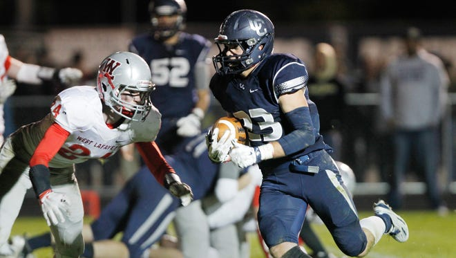 Jackson Anthrop rushes for an eight yard touchdown at 1:37 in the second quarter against West Lafayette Friday, October 16, 2015, in Lafayette. Anthrop's score put CC up 21-13 over West Lafayette. CC would go on to beat their conference rival 38-20.