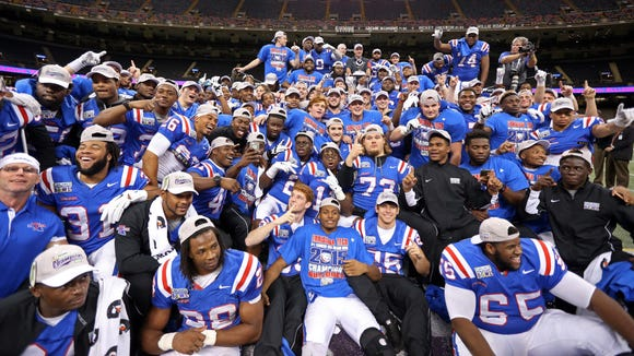 The Louisiana Tech Bulldogs players celebrate their